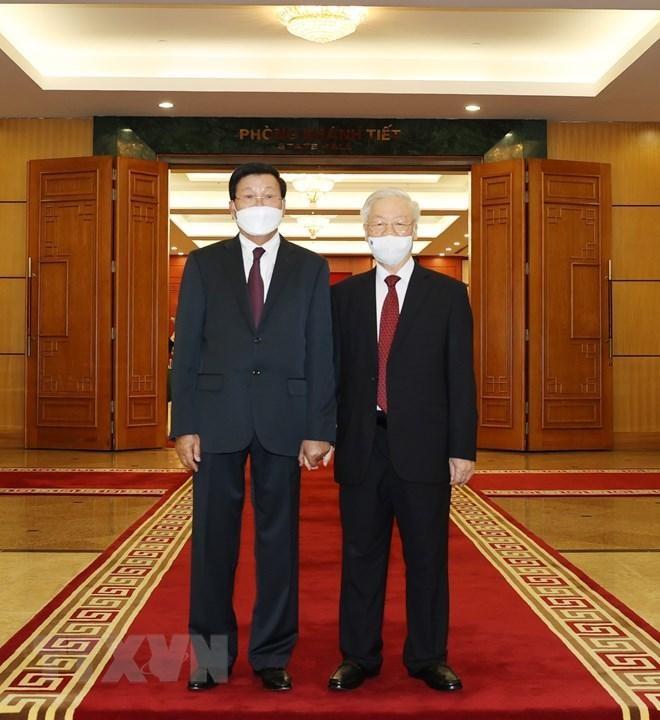 Chủ tịch nước Nguyễn Xuân Phúc chủ trì đón Tổng Bí thư, Chủ tịch Lào ảnh 5