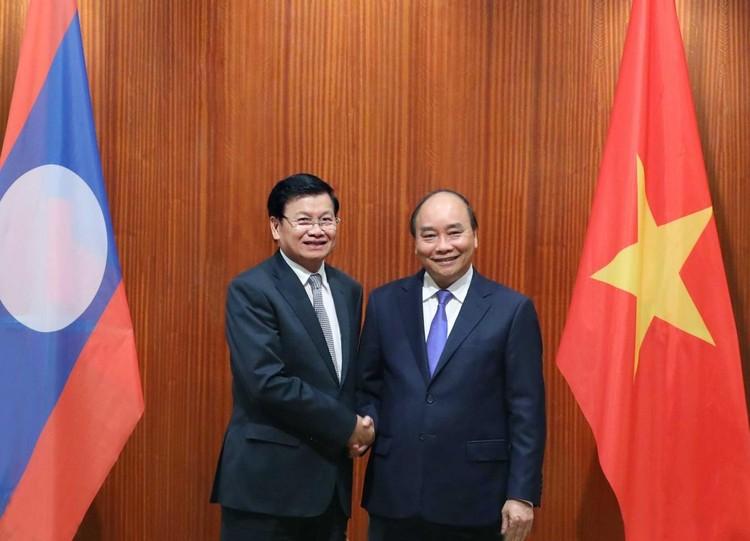 Chủ tịch nước Nguyễn Xuân Phúc lên đường thăm chính thức CHDCND Lào ảnh 1