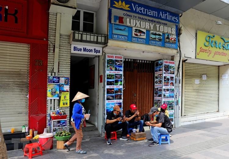 Hàng loạt cửa hàng ở TP Hồ Chí Minh phải đóng cửa do ế ẩm ảnh 4