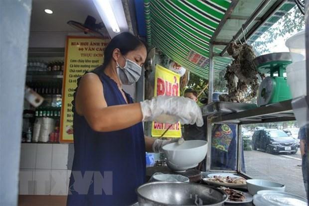 Nhiều hộ kinh doanh ở Hà Nội vui mừng khi được hoạt động trở lại ảnh 1